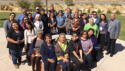 Photo of a group of community health workers outside at the Community Health Representative Policy Summit II